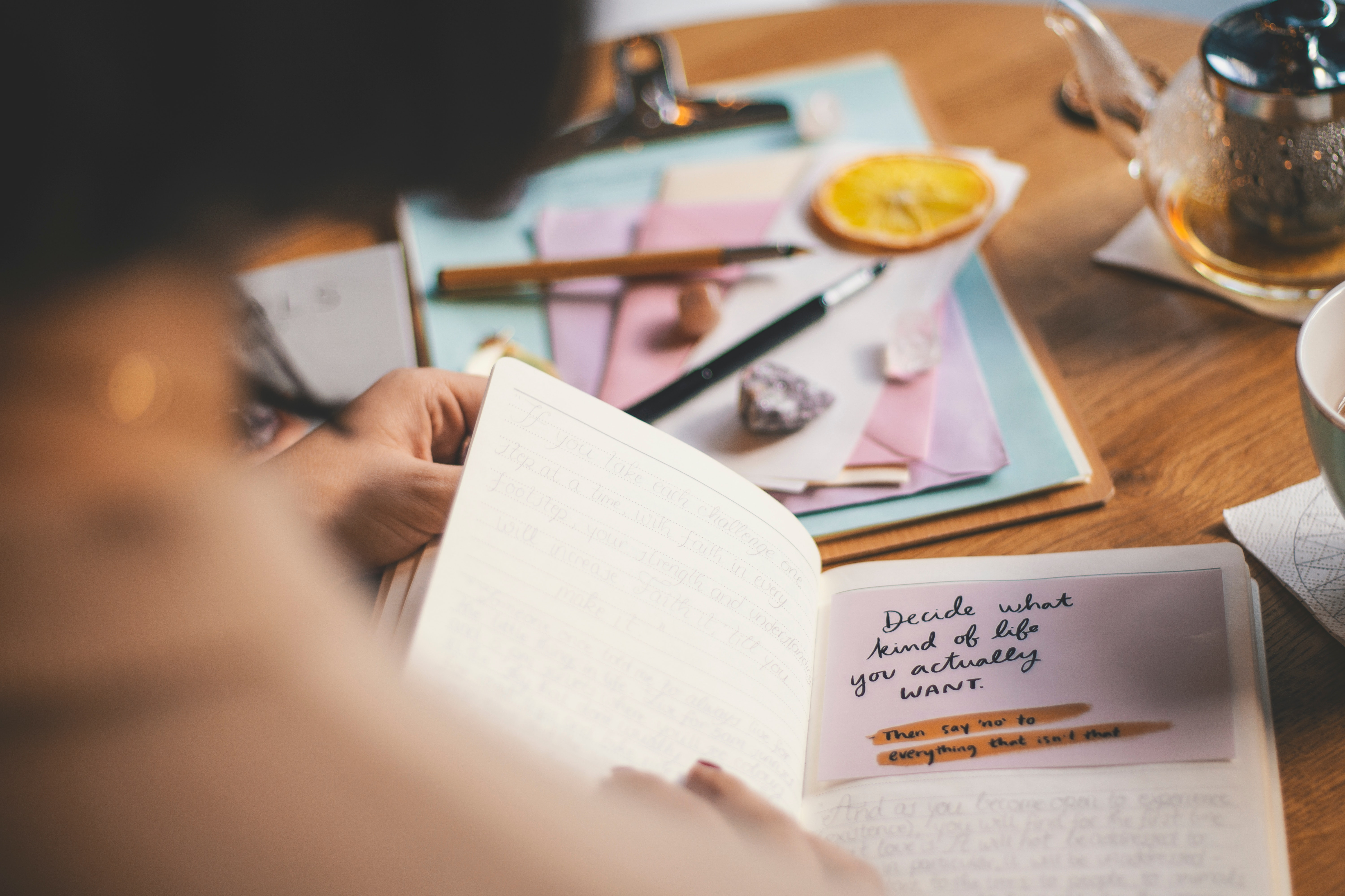 photo-of-person-holding-notebook-3363103
